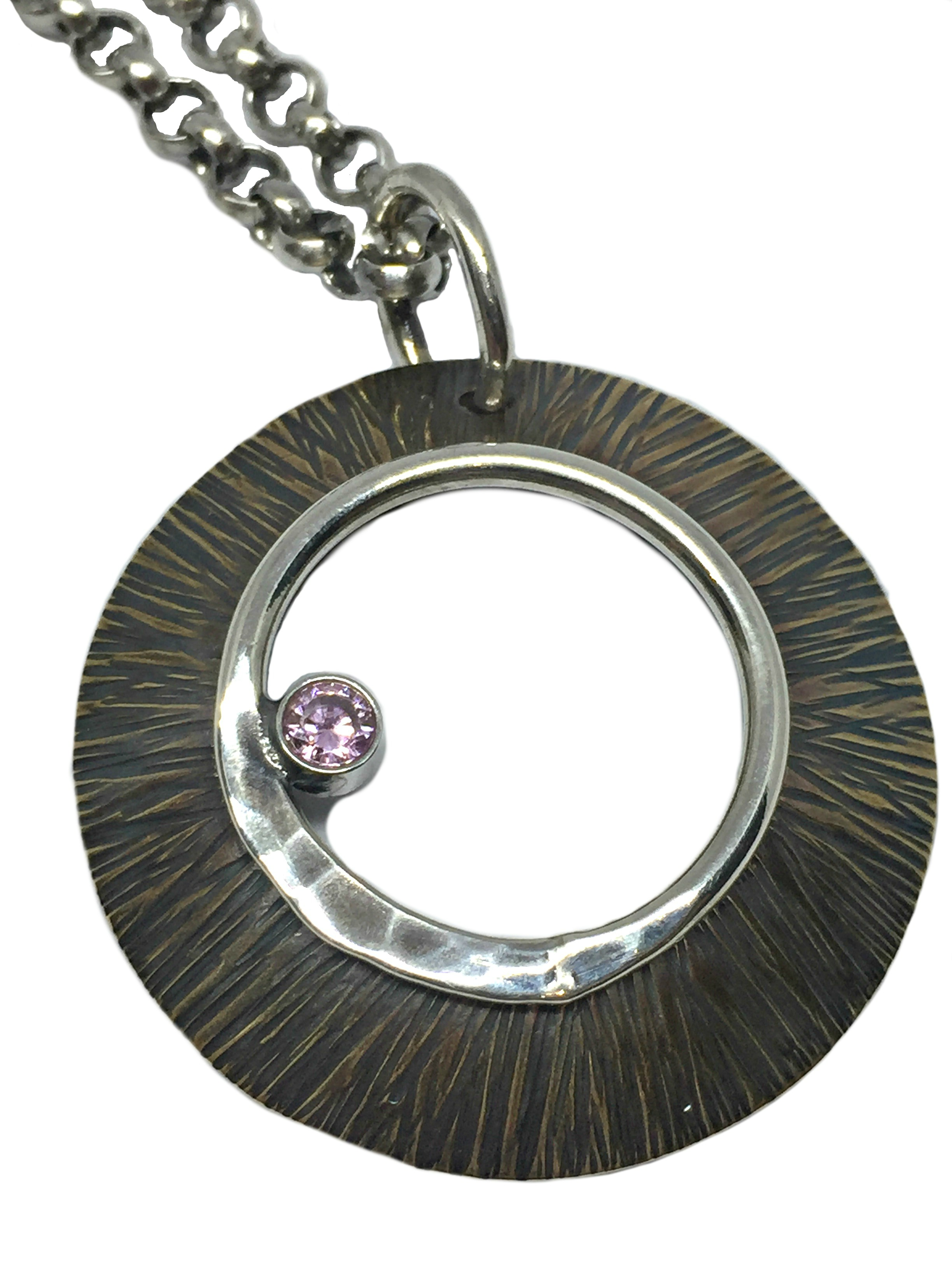 Bronze, sterling silver, + pink CZ pendant by Karyn Chopik | Effusion Art Gallery + Cast Glass Studio, Invermere BC