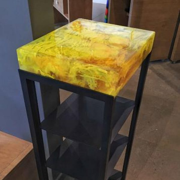 Cast glass magazine stand by Heather Cuell