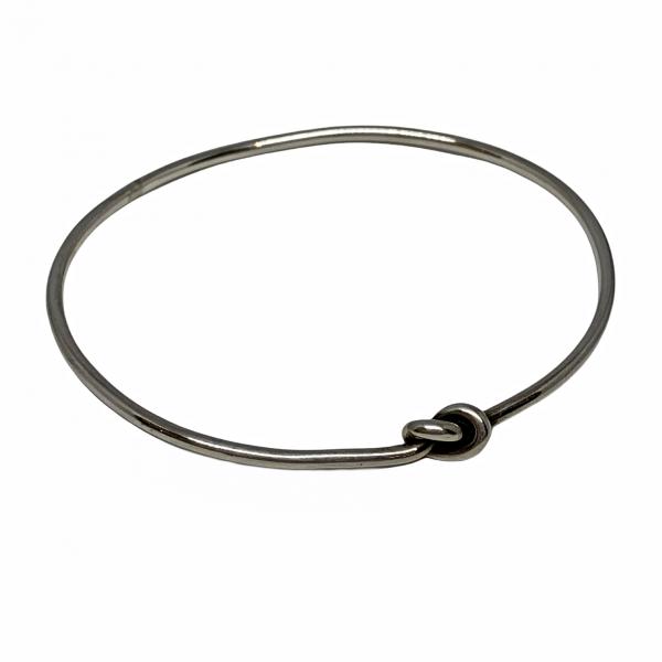 Handmade sterling silver love knot bangle by Karyn Chopik   Effusion Art Gallery + Cast Glass Studio, Invermere BC