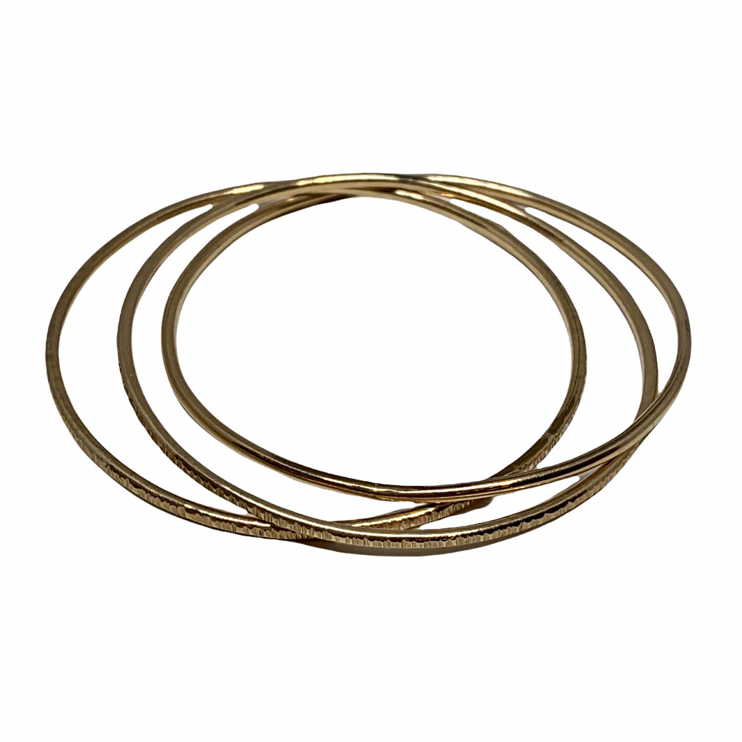 Handmade interlocking 14kt gold-fill bangles by Karyn Chopik | Effusion Art Gallery + Cast Glass Studio, Invermere BC