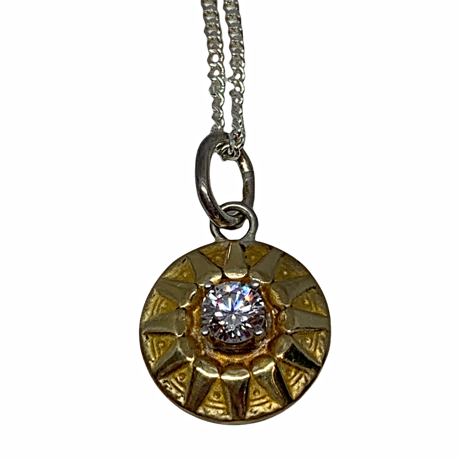 Handmade sterling silver, bronze, and CZ sundial necklace by Karyn Chopik | Effusion Art Gallery + Cast Glass Studio, Invermere BC