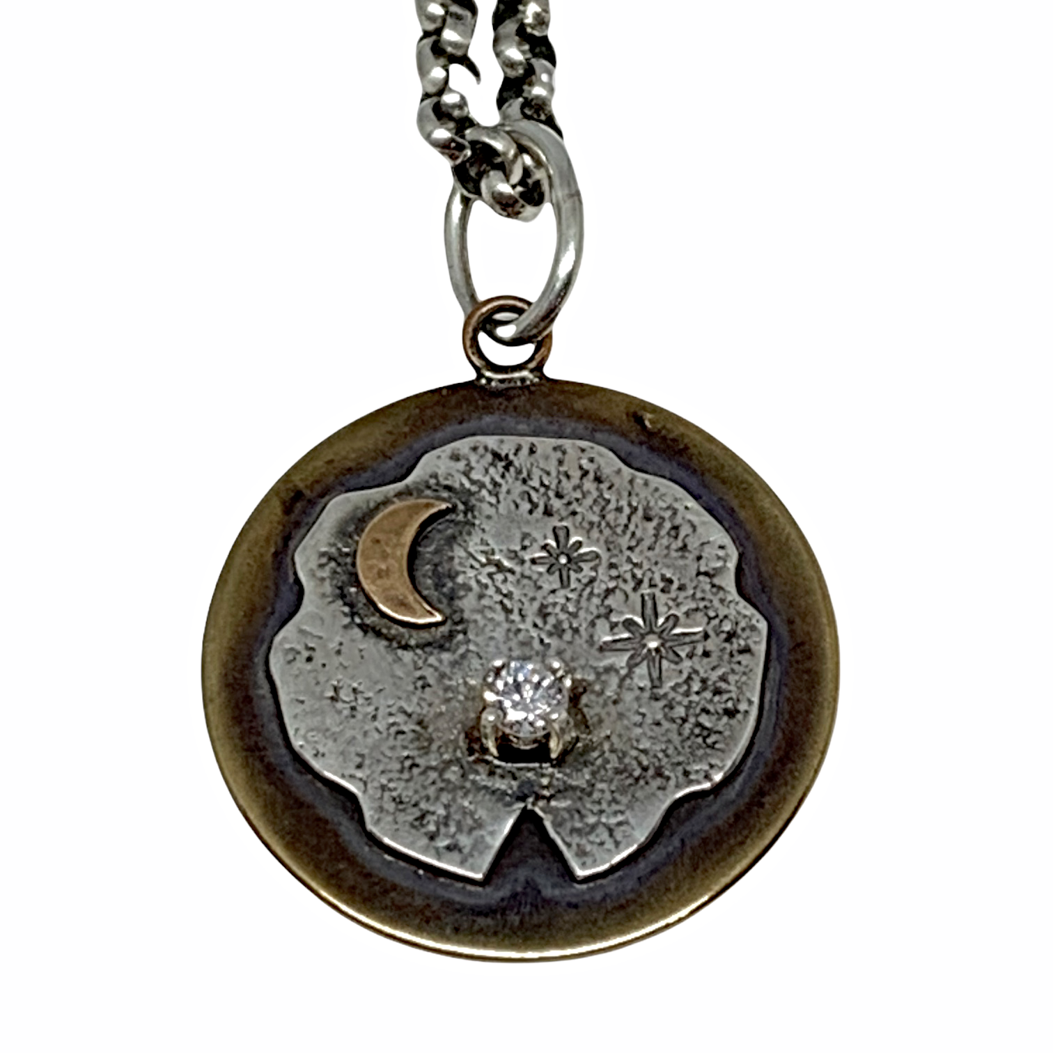 Handmade sterling silver, bronze, and CZ celestial pendant  by Karyn Chopik | Effusion Art Gallery + Cast Glass Studio, Invermere BC