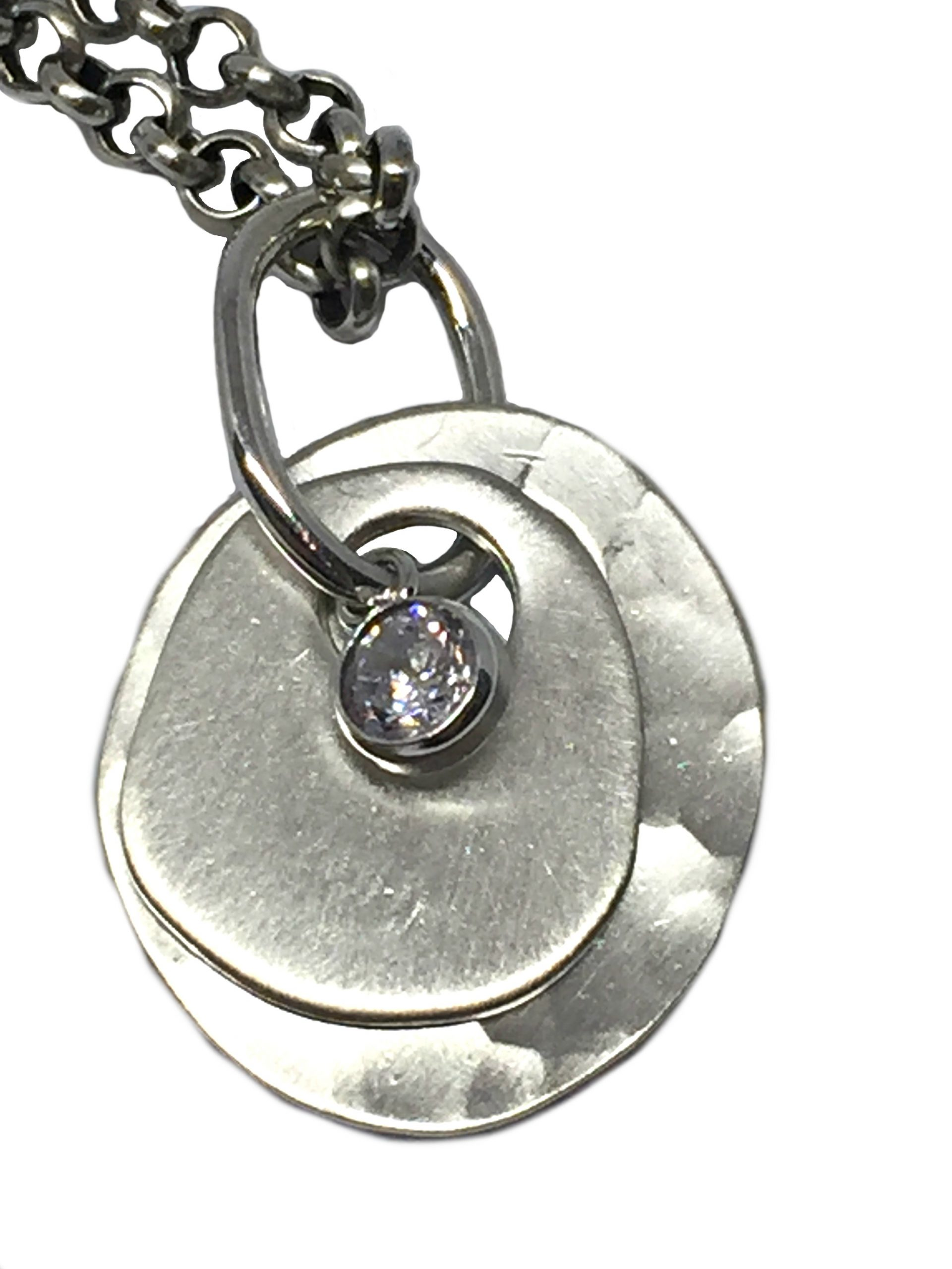 Sterling silver, and CZ pendant by Karyn Chopik   Effusion Art Gallery + Cast Glass Studio, Invermere BC
