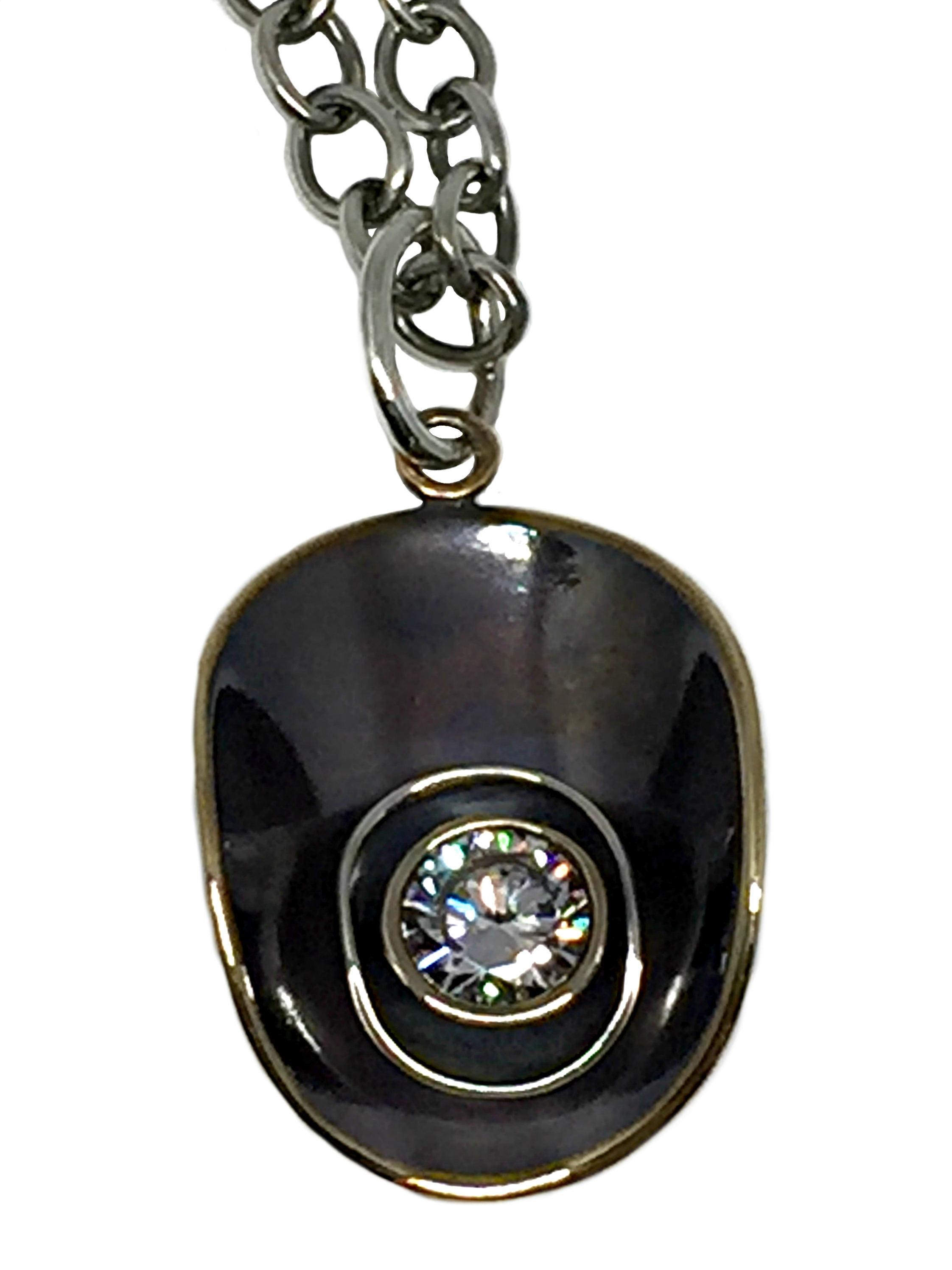 Bronze, Sterling Silver, + CZ Karyn Chopik pendant | Effusion Art Gallery + Cast Glass Studio, Invermere BC