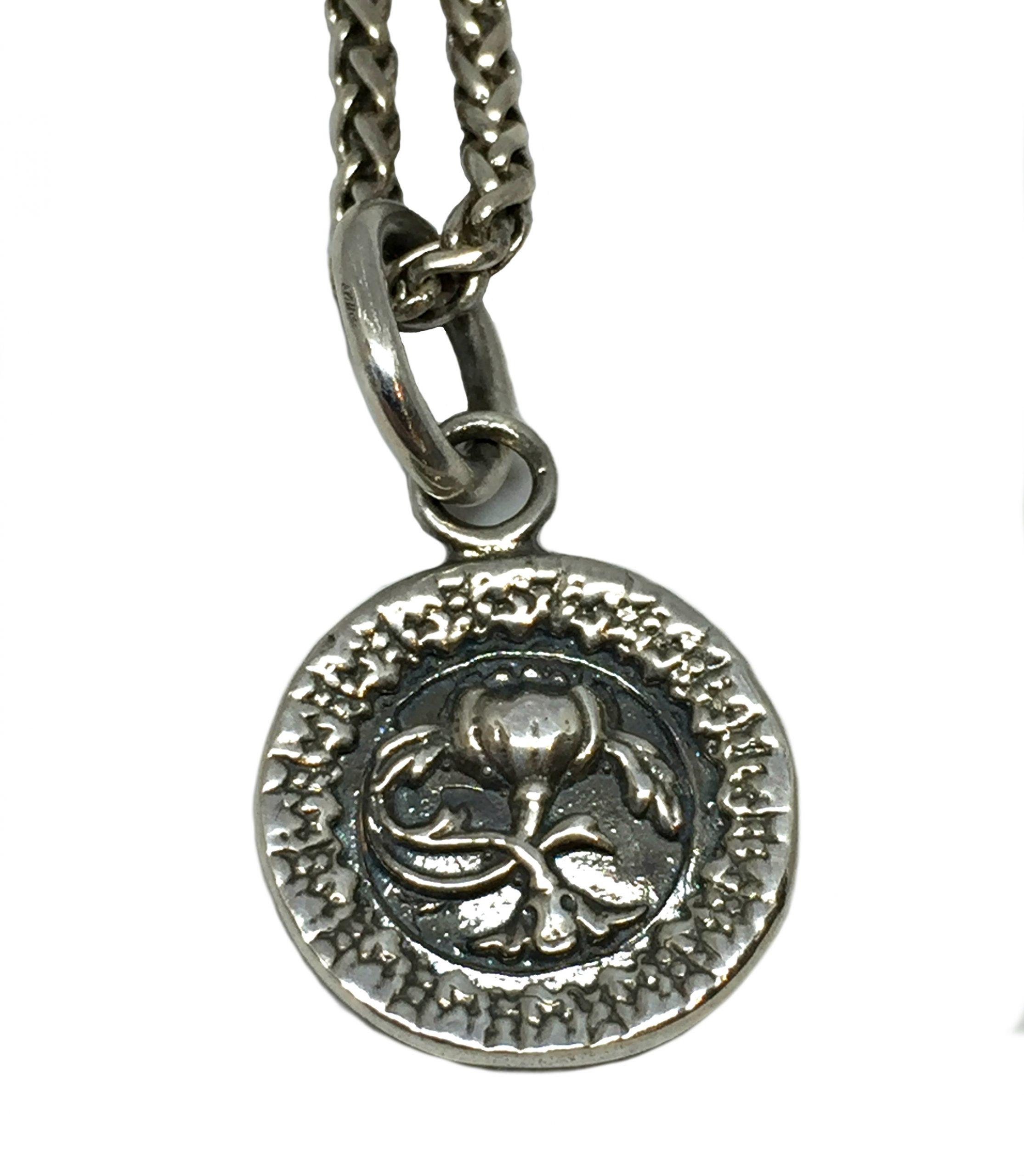 Sterling silver flower pendant by Karyn Chopik   Effusion Art gallery + Cast Glass Studio, Invermere BC