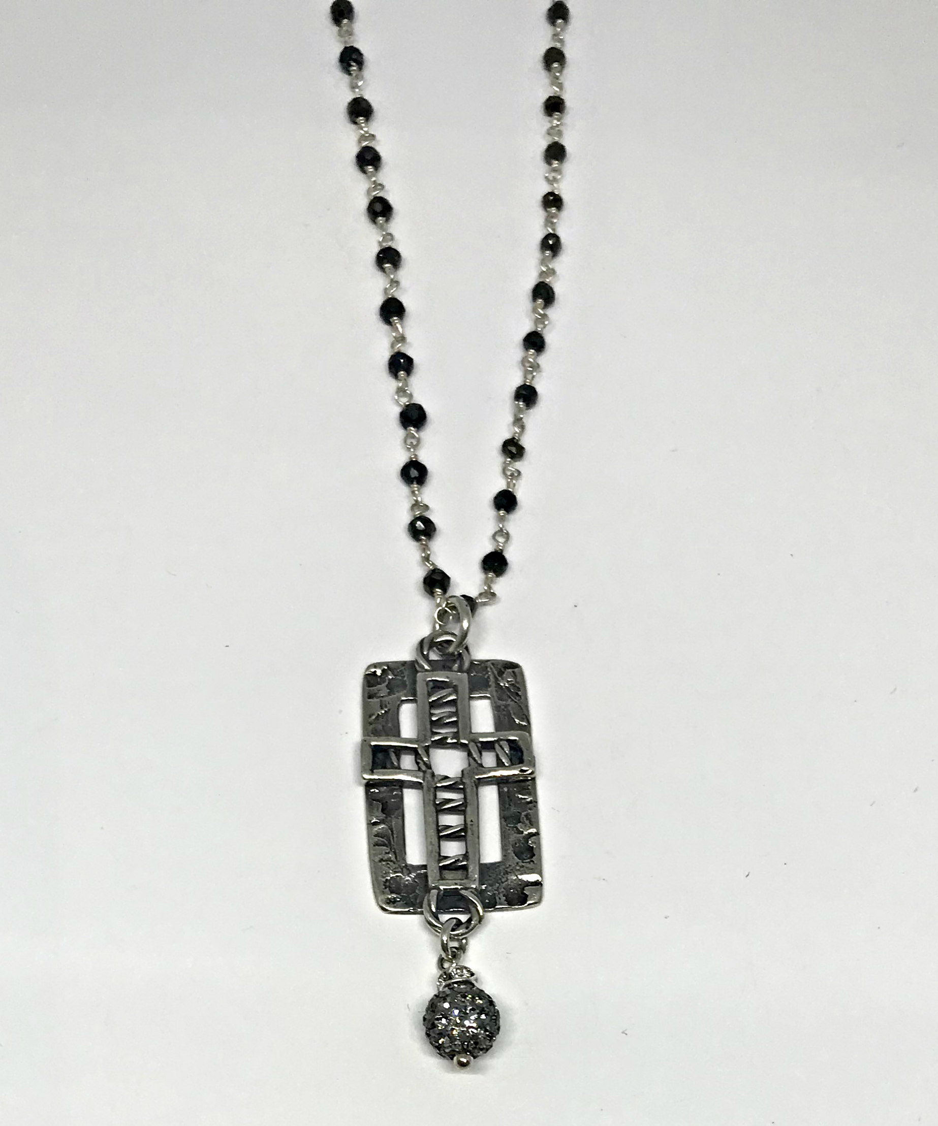 A Time of Need, sterling silver and hematite cross necklace by Karyn Chopik | Effusion Art Gallery + Cast Glass Studio, Invermere BC