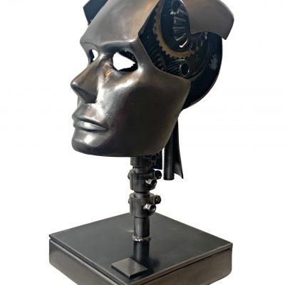 Imagine, steel head sculpture by Cory Fuhr   Effusion Art Gallery + Cast Glass Studio, Invermere BC