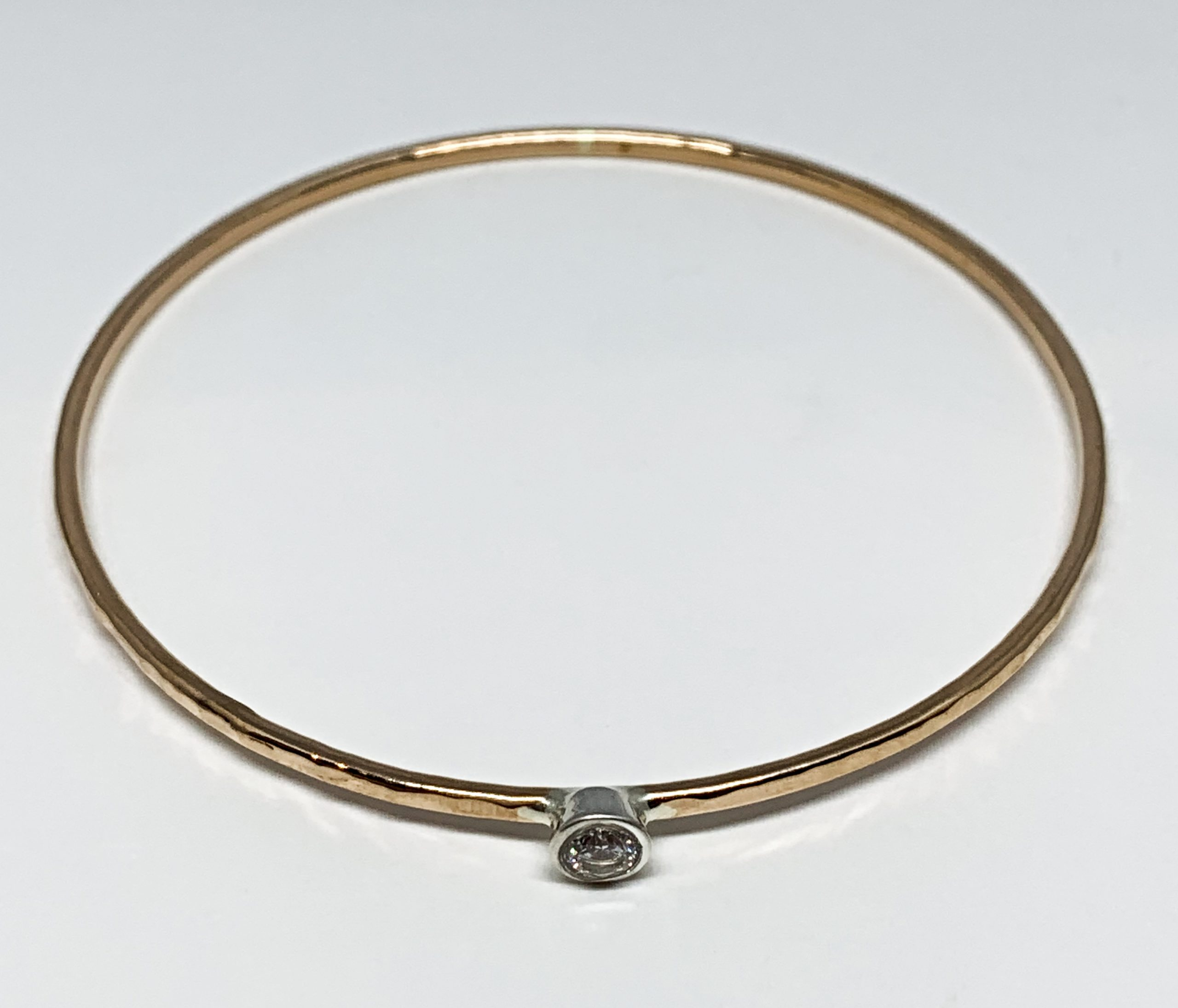 Bronze, silver, and CZ bangle by Karyn Chopik | Effusion Art Gallery + Cast Glass Studio, Invermere BC