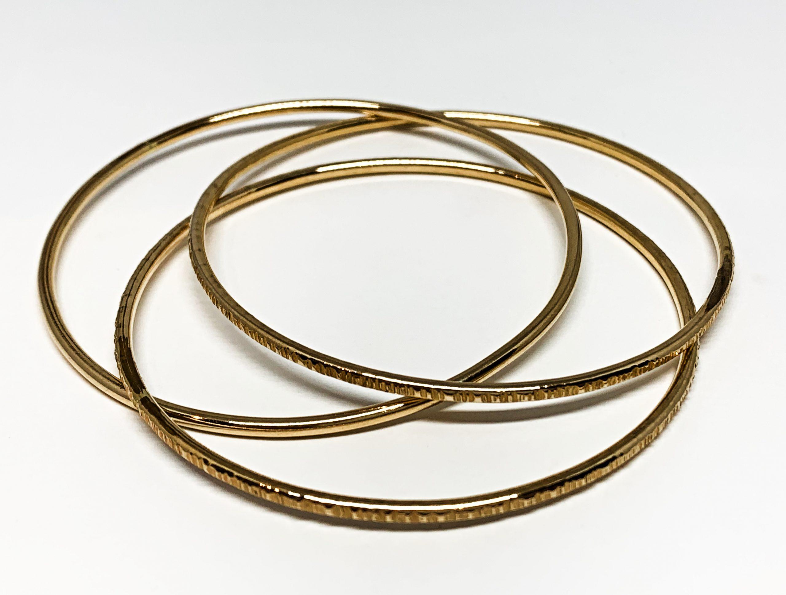 14 karat gold-fill interlocking bangles by Karyn Chopik | Effusion Art Gallery + Cast Glass Studio, Invermere BC
