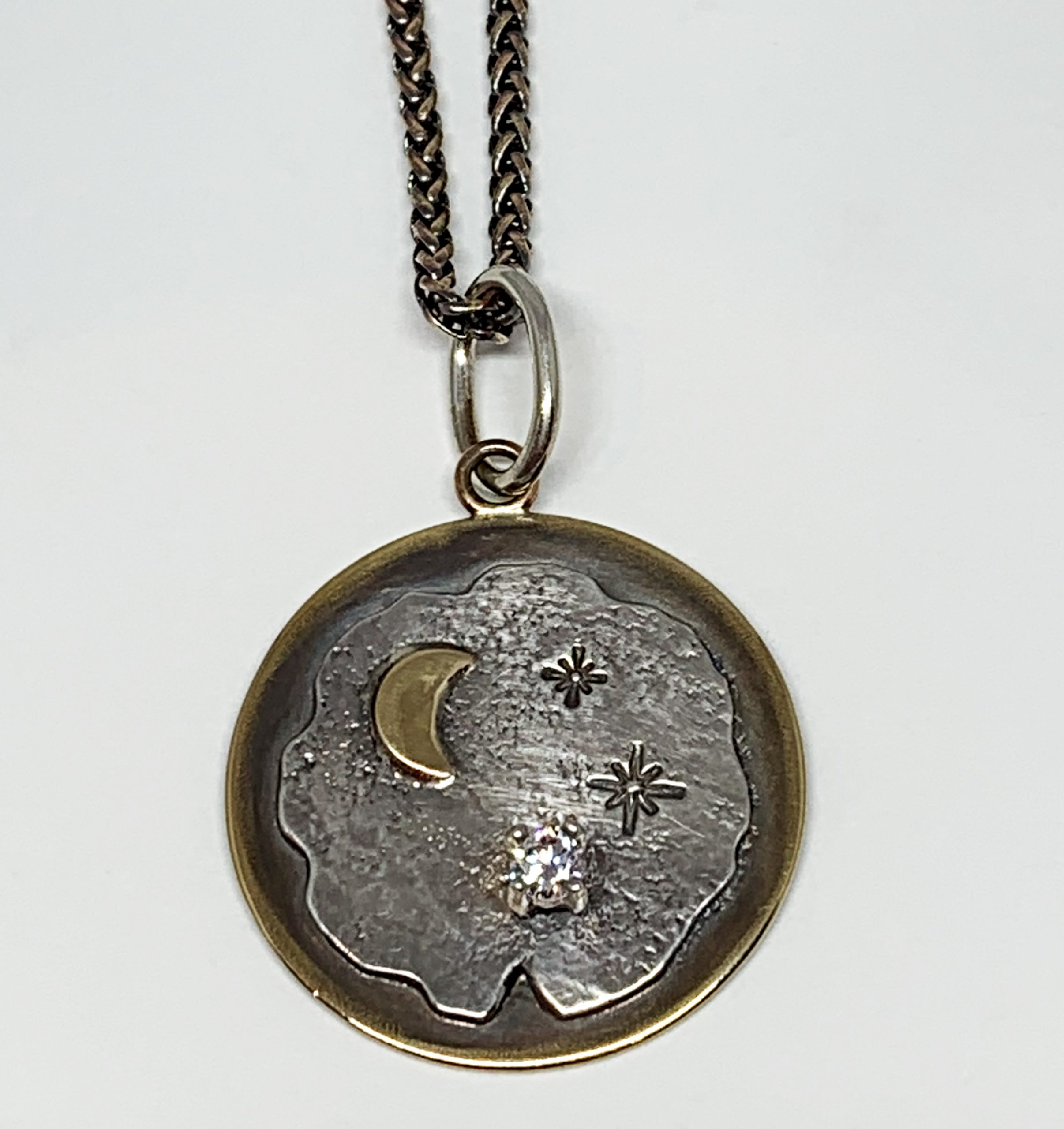 Bronze, sterling silver, and CZ night sky pendant by Karyn Chopik   Effusion Art Gallery + Cast Glass Studio, Invermere BC